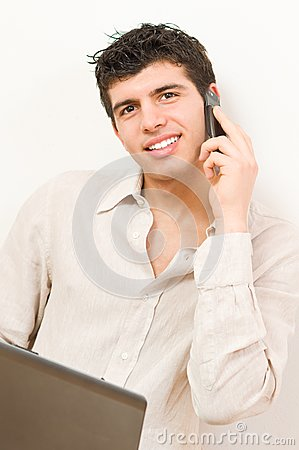 Young man on laptop and mobile