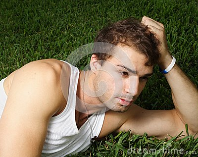 Young man laying on the grass