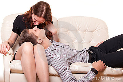 Young man lies in the lap of woman