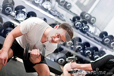 Young man lifting bumbbell