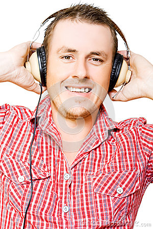 Young man listening to music through earphones