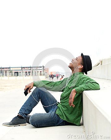 Free Young Man Listening To Music On Mobile Phone Royalty Free Stock Photography - 40012267
