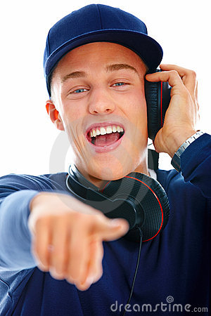 Young man listening to music and pointing