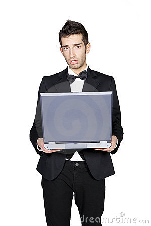 Young man looking confused and holding laptop