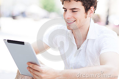 Young man looking at digital tablet