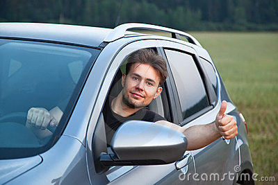 Young man looking out of car