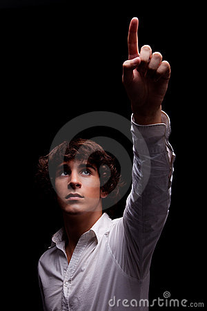 Young man  looking up to the light and pointing