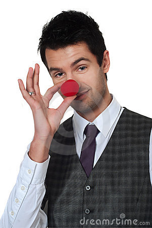 Young man magican making clown nose