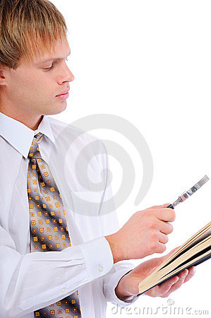 Young man with magnifier by read book