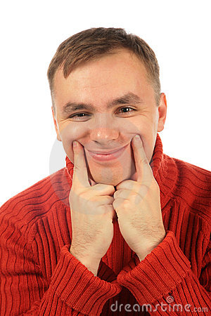 Young man makes smile with  fingers