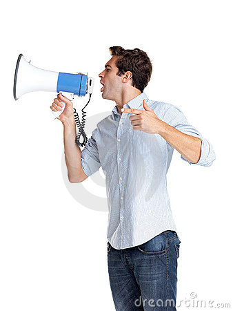 Young man making announcement over a megaphone