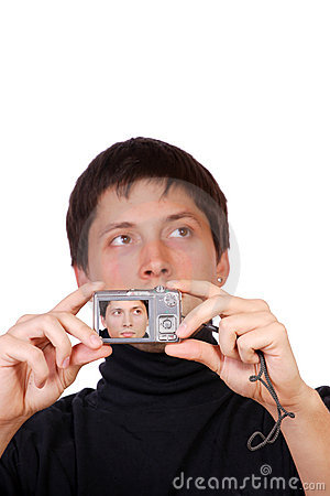 Young man is making a photo with compact camera