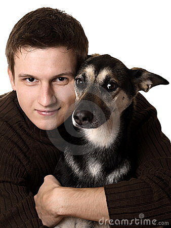 Young man with mixed breed dog