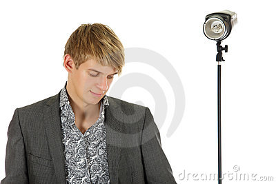 Young man model looking down, strobe behind