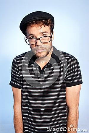 Young man modern nerd wide angle portrait blue