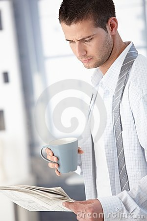 Young man in the morning with tea