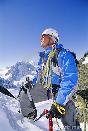 Free Young Man Mountain Climbing On Snowy Peak Royalty Free Stock Photography - 6077477