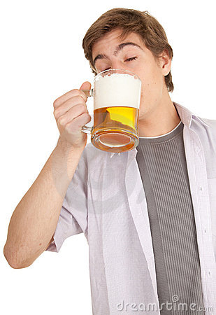 Young man with mug of beer