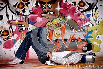 Young man music, graffiti wall
