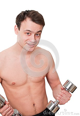 Young man with naked torso with dumbbells