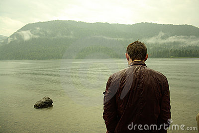 Young man near lake