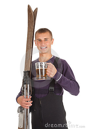 Young man with old wooden ski and mug of beer