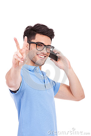 Free Young Man On The Phone Showing Peace Royalty Free Stock Photography - 26964277