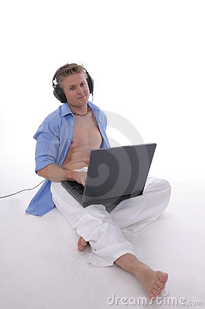 Young man with open laptop