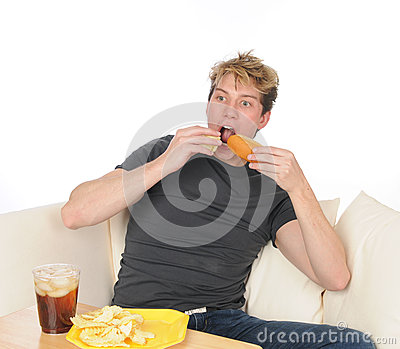 Young man overeating