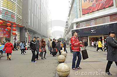 A young man pass through a busy street Editorial Image