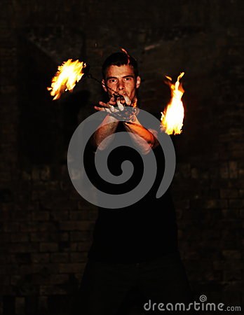 Young Man Performing with Fire