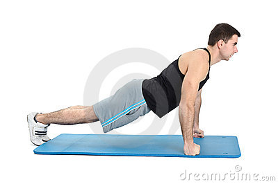 Young man performing push-ups exercise on fists