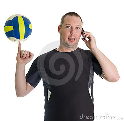 Young man performing trick with volley ball