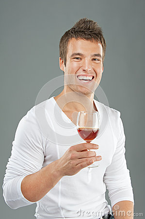 Young man pick up a wineglass