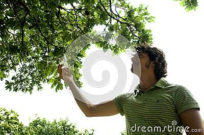 Young man picking an energy saving