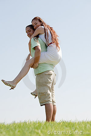 Young Man Piggybacking His Girlfriend