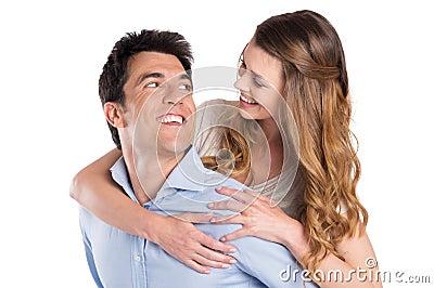 Young Man Piggybacking Woman