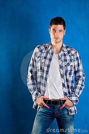 Young man with plaid shirt denim jeans in blue