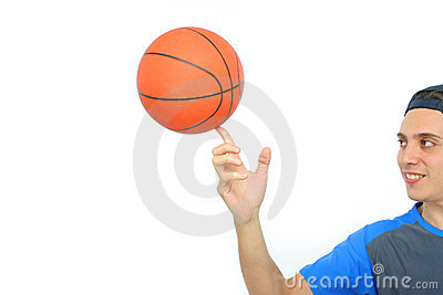Young man playing basketball isolated