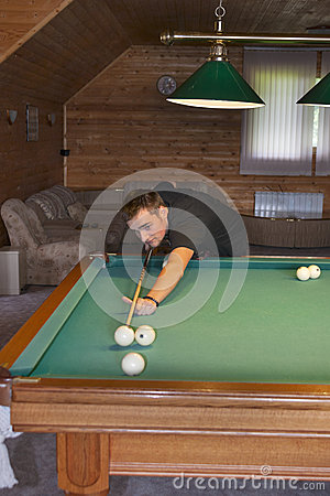 Young man playing billiards