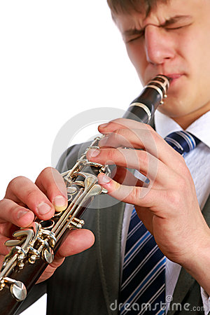 A young man playing the clarinet