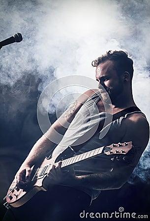 Rocker Play Guitar in Concert