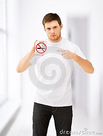 Free Young Man Pointing At No Smoking Sign Stock Image - 38012601
