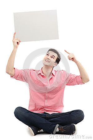 Young man pointing at blank sign