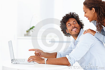 Young man pointing at the laptop screen