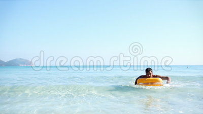 Young man on pool raft. In the mediterranean sea, majorca stock footage