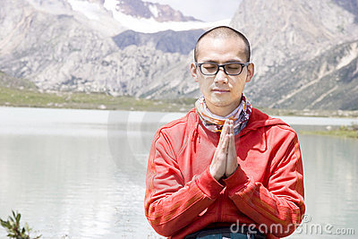 Young man pray in nature