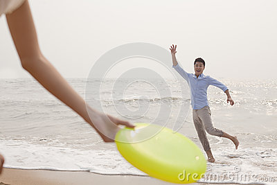 Young man preparing to catch Frisbee