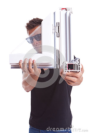 Young man presenting a pvc window sample