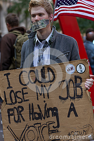 Young man with protest sign at Occupy Wall Street Editorial Photo